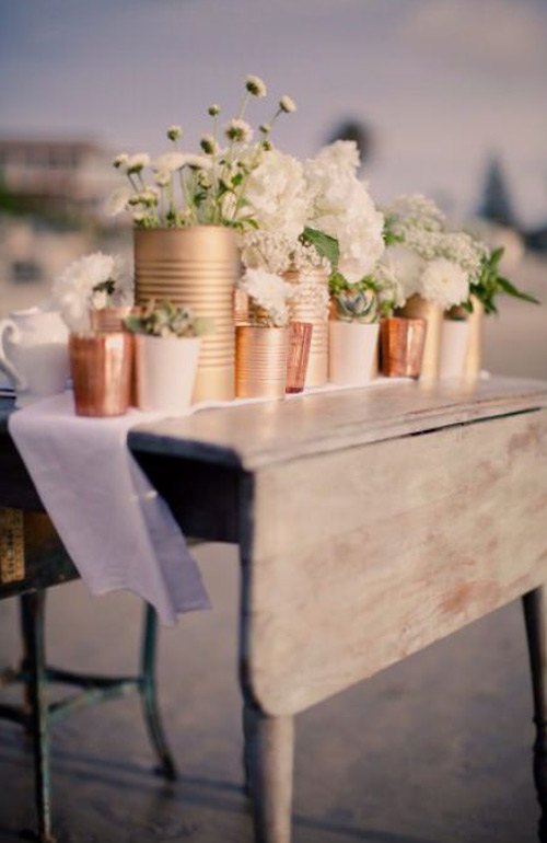 Rose gold centrepieces rustic table setting