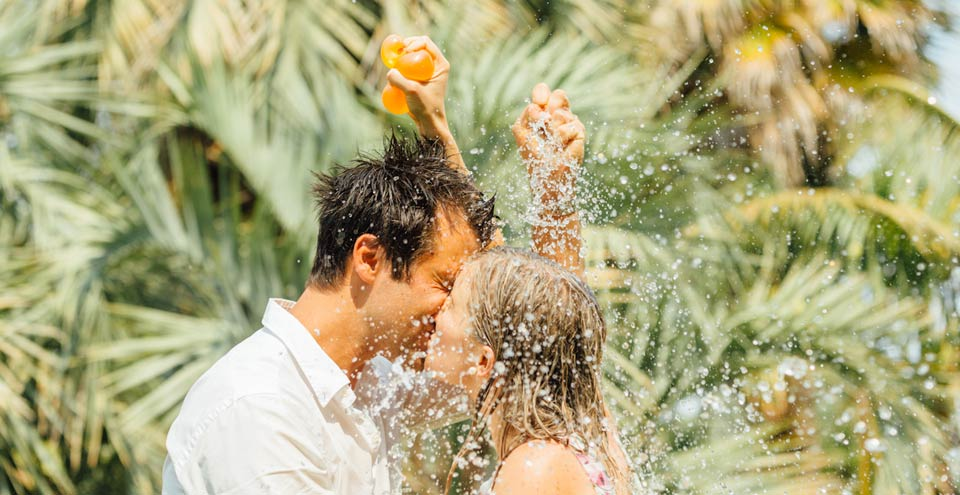 Engagement shoot water balloons